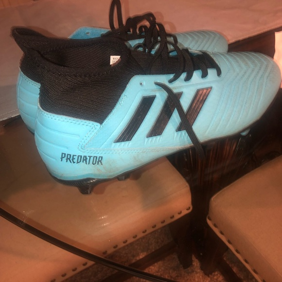 Men's Predator adidas cleats.